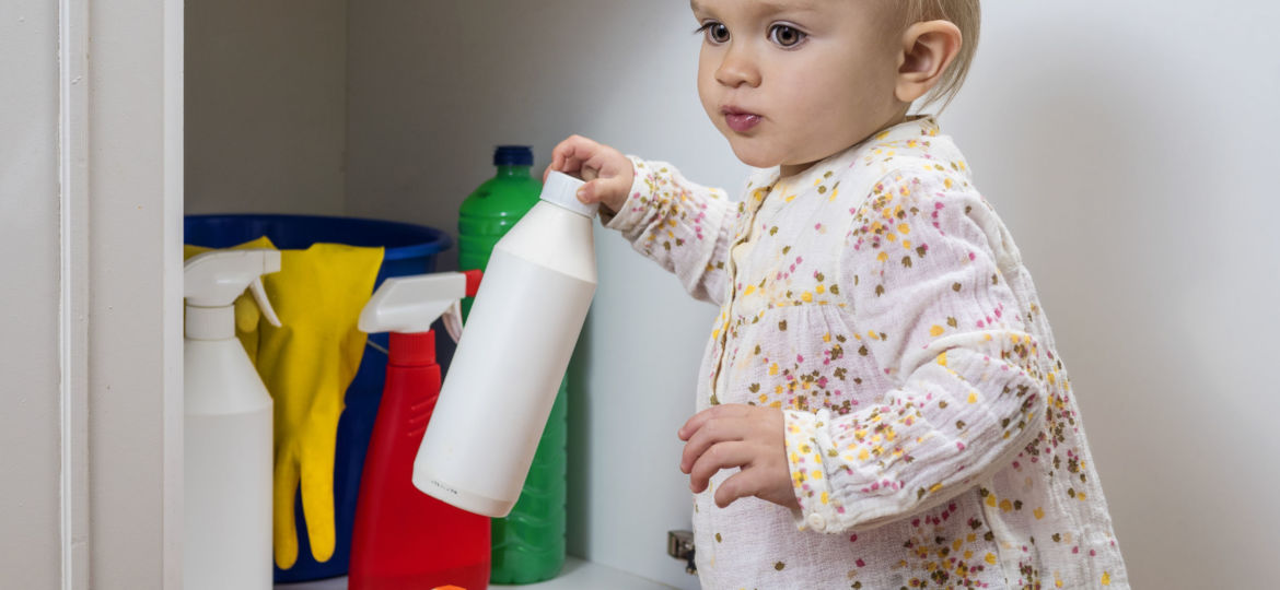 47589874 - toddler playing with household cleaners at home